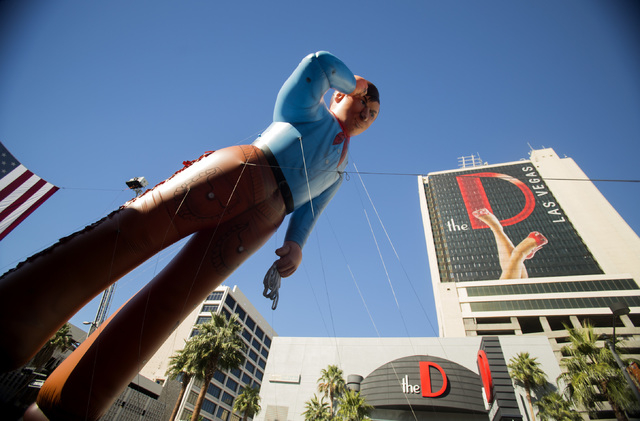 The Cox Cable inflatable cowboy during the   Nevada Day Parade on Fourth Street in downtown Las Vegas on Friday, Oct. 31. Thousands lined the street to celebrate Nevada's  Sesquicentennial. (Jeff  ...