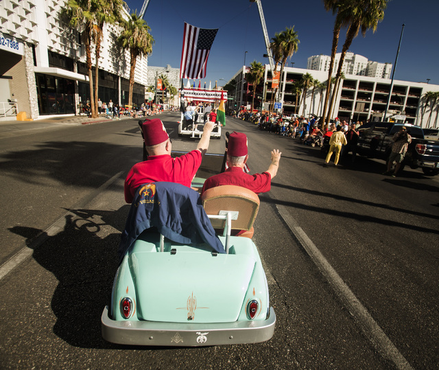 Zelzah Shriners Las Vegas Jerry Eitel, left, and Jim Denney wave during the   Nevada Day Parade on Fourth Street in downtown Las Vegas on Friday, Oct. 31. Thousands lined the street to celebrate N ...