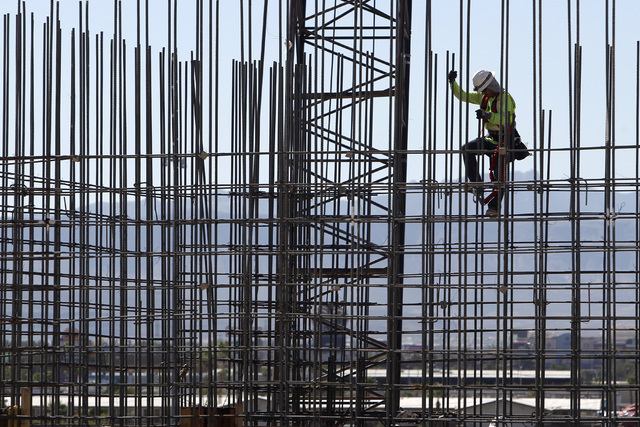 A construction worker climbs down rebar on the site of the MGM Arena Sept. 19, 2014 in Las Vegas. Unemployment in Nevada was 7.3 percent in September, its lowest level since July 2008. (Sam Morris ...