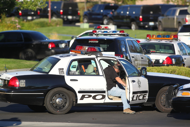 Las Vegas police and SWAT respond to a barricade situation at a home on the 8500 block of Berkley Hall Street in northwest Las Vegas on Monday morning, Oct. 20, 2014. Homicide investigators are cu ...