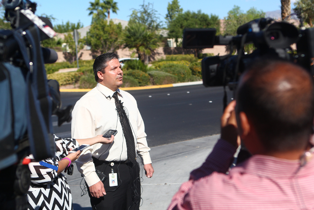 Las Vegas police homicide Lt. Ray Steiber speaks with news media after a police and SWAT responded to a barricade situation at a home in the 8500 block of Berkley Hall Street in northwest Las Vega ...