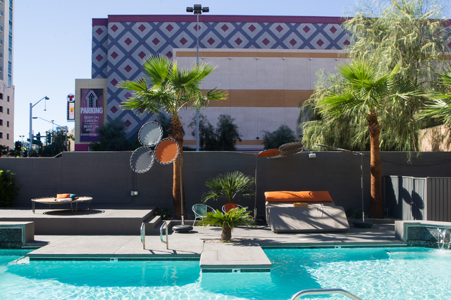 The pool area is seen at the Oasis at Gold Spike, a 44-room boutique hotel operated by the Downtown Project, during a tour for news media in downtown Las Vegas on Tuesday, Oct. 21, 2014. (Chase St ...