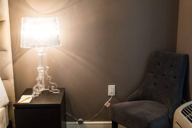 A lamp and chair are seen in a room at the Oasis at Gold Spike, a 44-room boutique hotel operated by the Downtown Project, during a tour for news media in downtown Las Vegas on Tuesday, Oct. 21, 2 ...