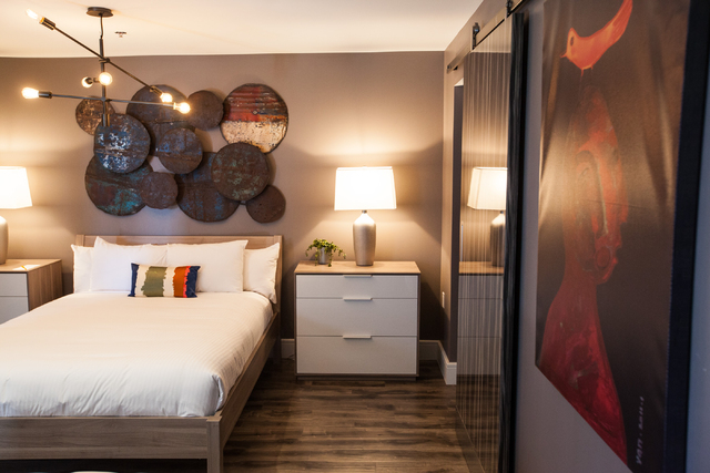 The bedroom area of a suite is seen at the Oasis at Gold Spike, a 44-room boutique hotel operated by the Downtown Project, during a tour for news media in downtown Las Vegas on Tuesday, Oct. 21, 2 ...
