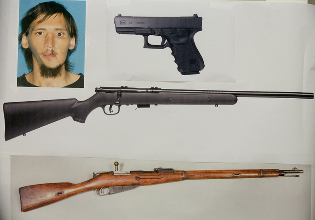 A photo provide by the Las Vegas Metropolitan Police Department of Patrick Heki, 26, and the guns he was carrying. Police released the photo during a press conference on Thursday, Dec. 12, 2013. T ...