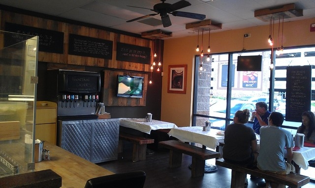 The atmosphere inside Old School Pizzeria, 2040 E. Craig Road, is cozy but classy, including wood accents and white tableclothes. (Lisa Valentine/View)