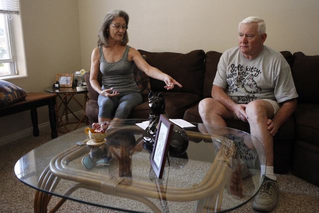 Diane Heilman, left, and her husband Brian, are interviewed about their medical conditions at their home in Las Vegas Thursday, Oct. 9, 2014. Diane Heilman uses hydrocodone, a drug to treat her rh ...