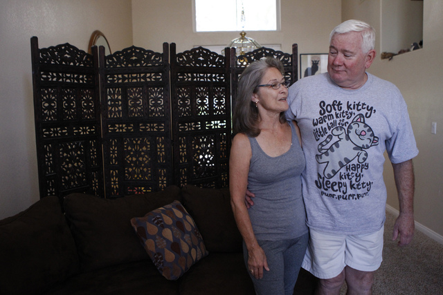 Diane Heilman, left, and her husband Brian, pose for a portrait at their home in Las Vegas Thursday, Oct. 9, 2014. Diane Heilman uses hydrocodone, a drug to treat her rheumatoid arthritis. The Dru ...
