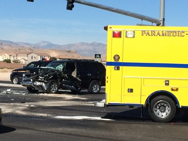 The intersection of Blue Diamond Road and Durango Drive is partially blocked after a Clark County fire truck and a smaller vehicle collided Friday morning, Oct. 31, 2014. (Bizuayehu Tesfaye/Las Ve ...