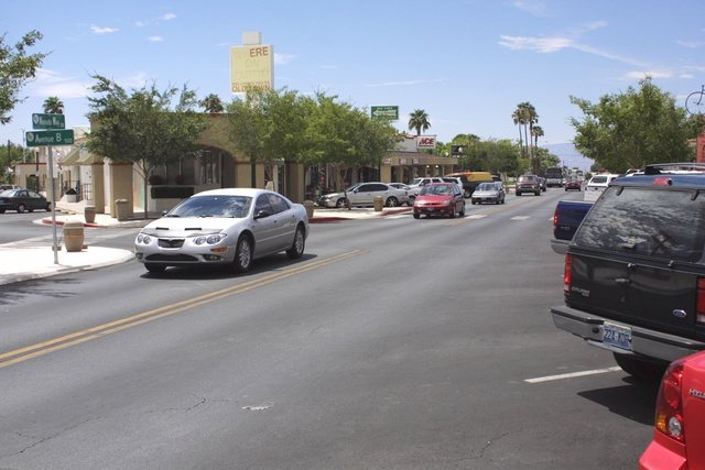 "Traffic moves along Nevada Way at Avenue B in downtown Boulder City, June 23, 2004. A parking study concluded limited parking on Nevada Way is a ""localized"" issue and that plenty of park ..."