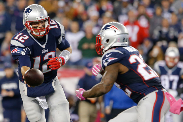 New England Patriots quarterback Tom Brady (12) hands off the ball to running back Stevan Ridley (22) against the Cincinnati Bengals during the second half at Gillette Stadium, Sunday, Oct. 5, 201 ...