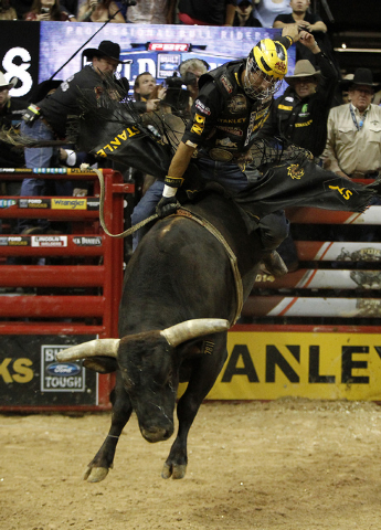 Silvano Alves rides Asteroid to win the 2014 Professional Bull Riders World Finals at the Thomas and Mack Arena in Las Vegas on Sunday, Oct. 26, 2014. (Justin Yurkanin/Las Vegas Review-Journal)
