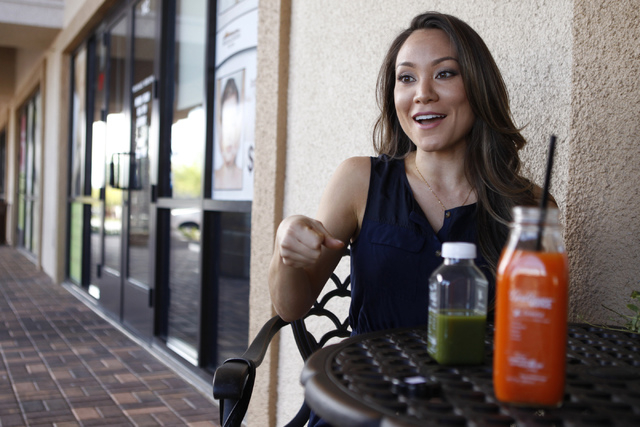 Jamie Stephenson, co-owner of The Juice Standard, is interviewed about her business outside of her shop in Las Vegas Saturday, Oct. 4, 2014. (Erik Verduzco/Las Vegas Review-Journal)