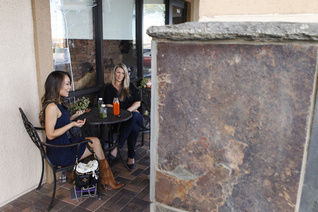 Co-owners of The Juice Standard Jamie Stephenson, left, and Marcella Melnichuk, are interviewed about their business outside of her shop in Las Vegas Saturday, Oct. 4, 2014. (Erik Verduzco/Las Veg ...