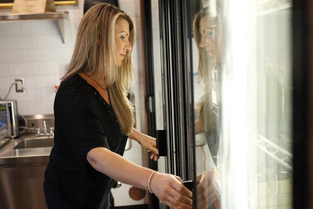 Marcella Melnichuk, co-owner of The Juice Standard, organizes her juice inventory inside of her shop in Las Vegas Saturday, Oct. 4, 2014. (Erik Verduzco/Las Vegas Review-Journal)