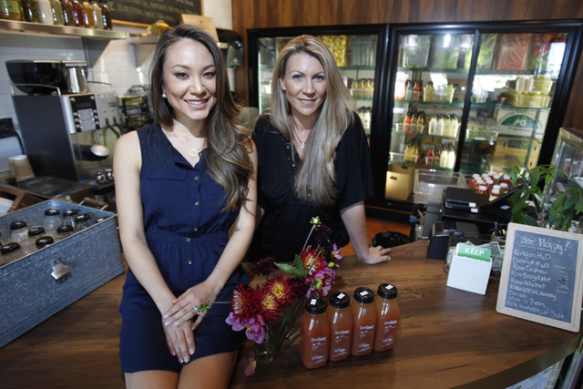 Co-owners of The Juice Standard Jamie Stephenson, left, and Marcella Melnichuk, pose for a portrait inside of their shop in Las Vegas Saturday, Oct. 4, 2014. (Erik Verduzco/Las Vegas Review-Journal)