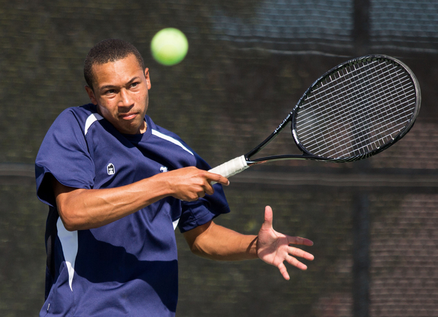Liberty's Al Gourrier competes in doubles during the Sunrise Region boys team championship at Darling Tennis Center on Friday, Oct. 10, 2014. The overall region title went to Coronado, 10-8. (Sama ...