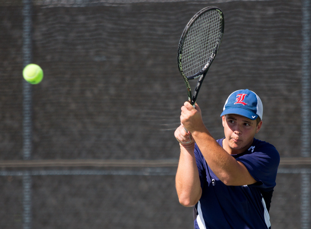 Liberty's Matt Drongensen competes in doubles during the Sunrise Region boys team championship at Darling Tennis Center on Friday, Oct. 10, 2014. The overall region title went to Coronado, 10-8. ( ...