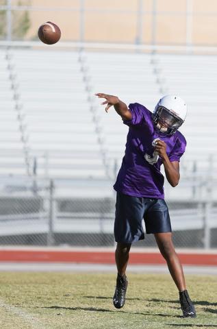 Sunrise Mountain senior quarterback Damon Heard throws the ball during a practice at Sunrise Mountain High School Wednesday, Oct. 15, 2014, in Las Vegas. Sunrise Mountain won their third varsity g ...