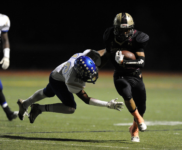 Sierra Vista safety Javion Hunt (16) tackles Faith Lutheran Crusaders wide receiver Christian Marshall in the first half of their high school football game at Faith Lutheran High School in Las Veg ...