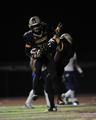 Faith Lutheran wide receiver Tyler Mahan (31) celebrates after scoring a touchdown with Robby Schwartz (3) in the second half of their high school football game at Faith Lutheran High School in La ...