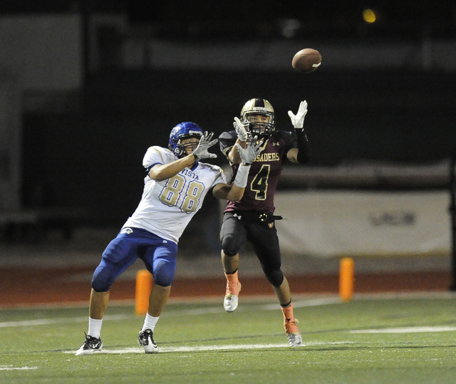 Faith Lutheran defensive back Christian Marshall (4) nearly intercepts a Sierra Vista pass intended for Sierra Vista tight end Monquel Glasow (88) in the second half of their high school football  ...