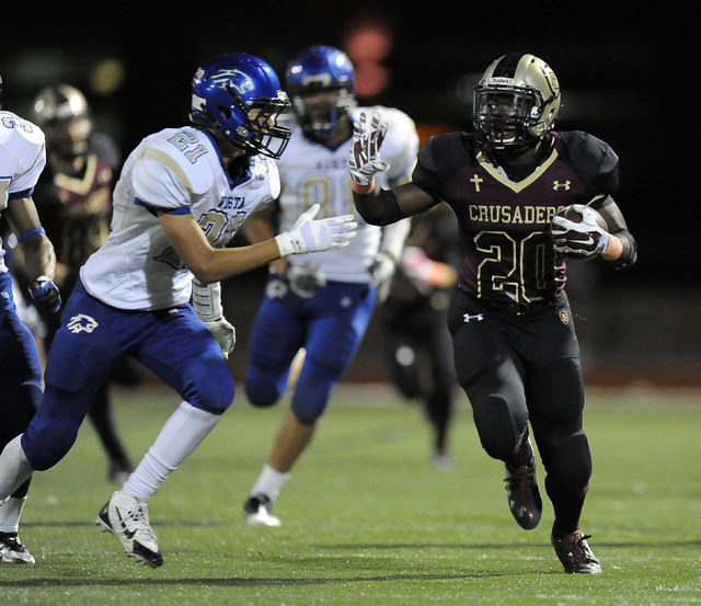 Faith Lutheran running back Alfred Soboyejo IV (20) gains a first down as Sierra Vista safety Colby Ceniza (21) closes in during the second half of their high school football game at Faith Luthera ...