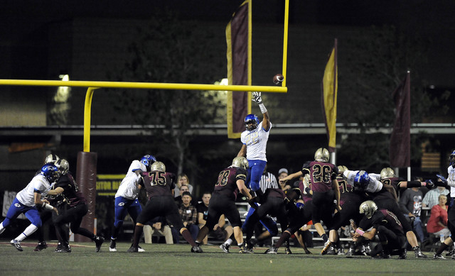 Sierra Vista linebacker Daniel Godfrey (22) tries to block a Faith Lutheran extra point attempt by kicker Ryan Callan (26) in the first half of their high school football game at Faith Lutheran Hi ...