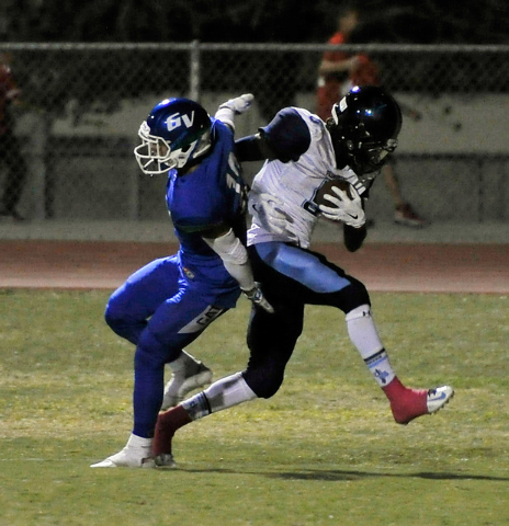 Canyon Springs' Kujuan Casey, right, runs in for a touchdown against Green Valley's Jacob Rivero during the second quarter of a high school football game at Green Valley High School on Friday, Oct ...