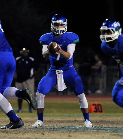 Green Valley quarterback Christian Lopez looks to hand off the ball against Canyon Springs during a high school football game at Green Valley High School on Friday, Oct. 17, 2014. (David Becker/La ...