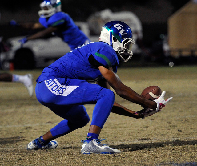 Green Valley's Isaiah Macklin reaches to make a catch against Canyon Springs during a high school football game at Green Valley High School on Friday, Oct. 17, 2014. (David Becker/Las Vegas Review ...