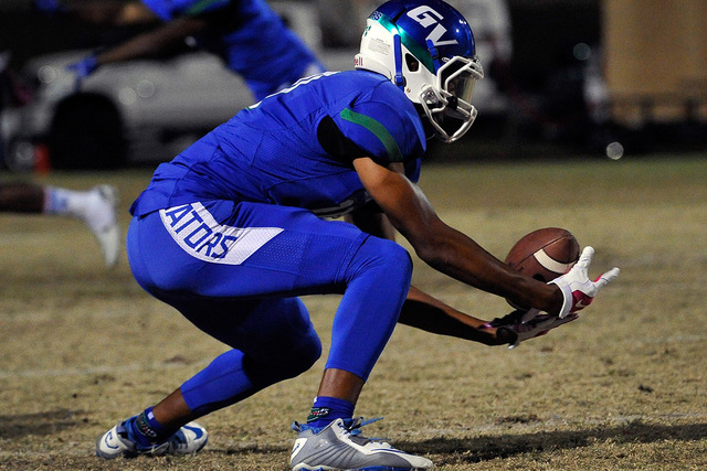Green Valley controls its own fate; it needs to win Thursday to be the No. 1 seed from the Southeast in the Sunrise Region. Isaiah Macklin of the Gators reaches to make a catch against Canyon Spri ...