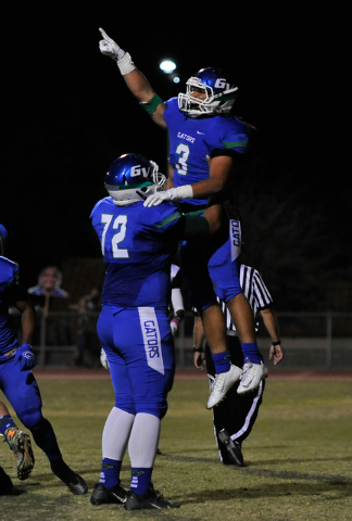 Green Valley's Brenan Adams (3) celebrates a first quarter touchdown with Joel Salakielu during a high school football game against Canyon Springs at Green Valley High School on Friday, Oct. 17, 2 ...