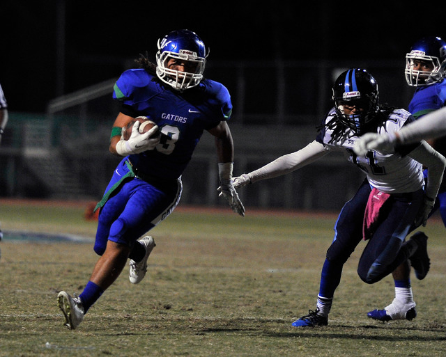Green Valley's Brenan Adams (3) runs with the ball during a high school football game against Canyon Springs at Green Valley High School on Friday, Oct. 17, 2014. (David Becker/Las Vegas Review-Jo ...