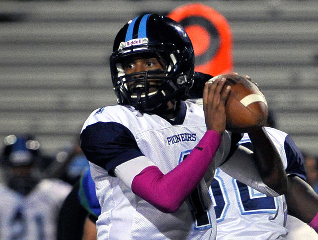 Canyon Springs quarterback Bradley Alexander looks to pass the ball against Green Valley during a high school football game at Green Valley High School on Friday, Oct. 17, 2014. (David Becker/Las  ...