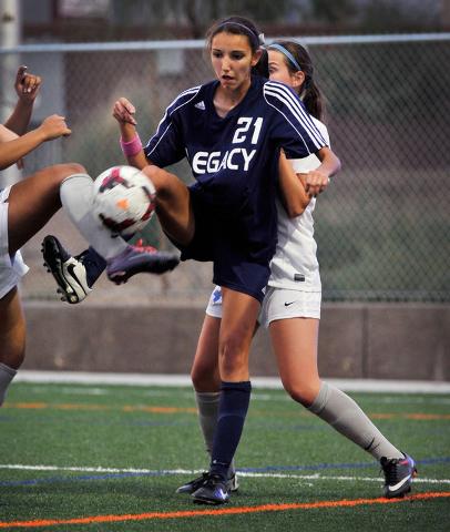 Legacy High School's Nadia Hernandez (21) is double teamed by Bishop Gorman defenders during a soccer match at Bishop Gorman High School on Tuesday, Oct. 7, 2014. Hernandez, the area's top goal sc ...