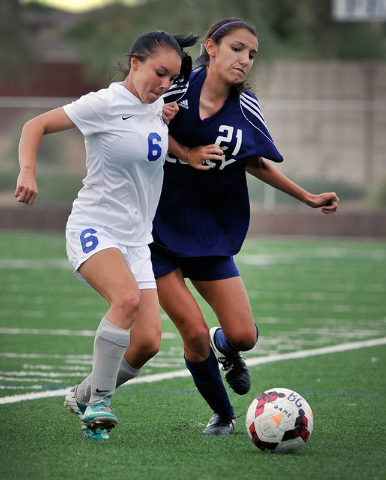 Legacy High School's Nadia Hernandez (21) chases down the ball against Bishop Gorman's Jordan Karsting during a soccer match at Bishop Gorman High School on Tuesday, Oct. 7, 2014. Hernandez, the a ...