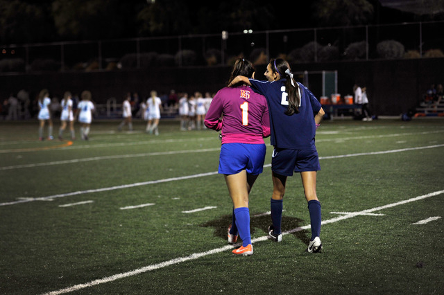 Legacy High School's Nadia Hernandez (21) Bishop Gorman goalie Jessica Anaya walk off the field together after a soccer match at Bishop Gorman High School on Tuesday, Oct. 7, 2014. Hernandez, the  ...