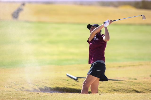 Faith Lutheran's Julia Becker knocks the ball out of the bunker on the Eldorado Valley course during the Division I-A Southern Region tournament at Boulder Creek Golf Club in Boulder City on Thurs ...