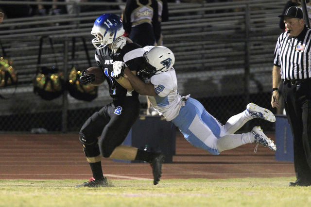 Basic wide receiver Chris Flum is brought down by Foothill defensive back Bobby Merritt during the first half of their game Friday, Oct. 17, 2014 at Basic High School.  (Sam Morris/Las Vegas Revie ...