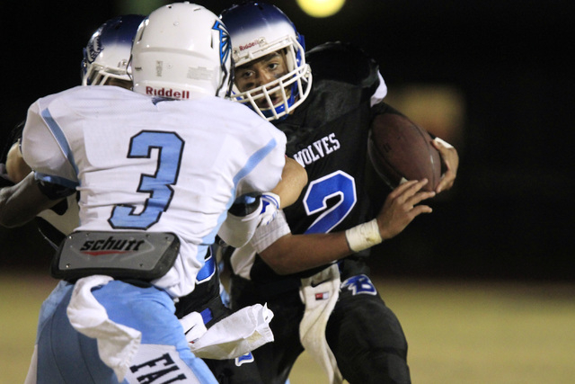 Basic quarterback Aeneas McAllister looks to get past Foothill defensive back Devin Smith during the first half on Friday.  (Sam Morris/Las Vegas Review-Journal)