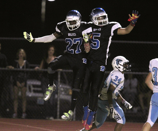 Basic wide receiver Josh Villaros, left, and wide receiver Tayj'ean Thomas celebrate Villaros' touchdown against Foothill during the first half of their game Friday, Oct. 17, 2014 at Basic High Sc ...