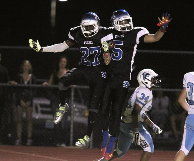 Basic wide receiver Josh Villaros, left, and wide receiver Tayj'ean Thomas celebrate Villaros' first-half touchdown catch against Foothill on Friday.  (Sam Morris/Las Vegas Review-Journal)