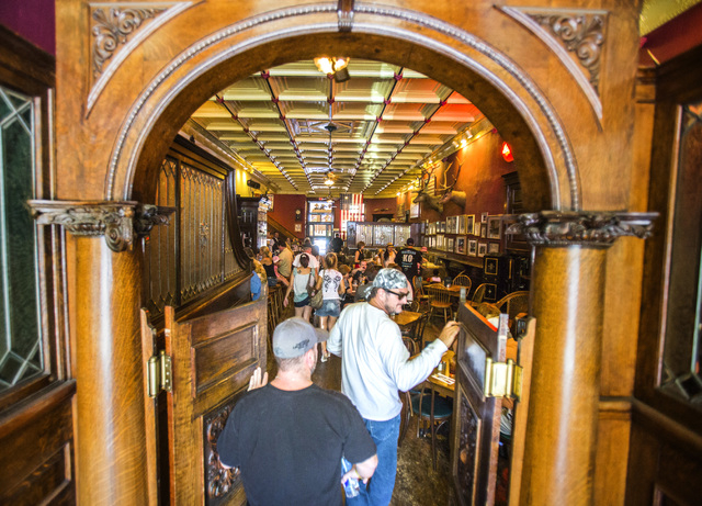 Men enter the historic Palace Restaurant and Saloon in Prescott, Ariz. on Sunday, June 15,2014. The popular watering hole along Whiskey Row opened in 1877.(Jeff Scheid/Las Vegas Review-Journal)