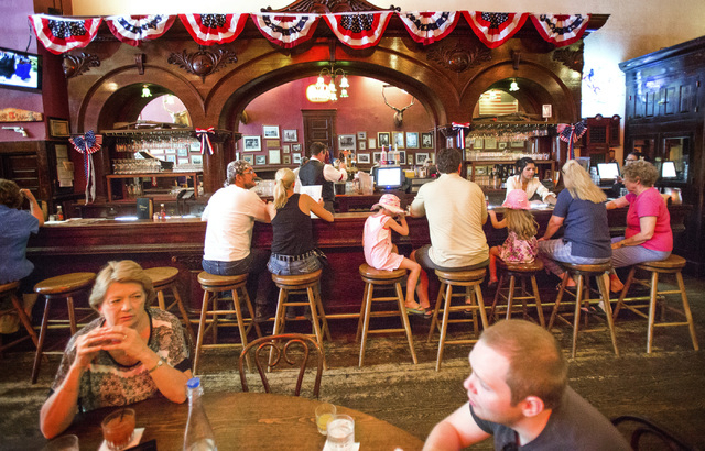 People gather at the historic Palace Restaurant and Saloon in Prescott, Ariz. on Sunday, June 15,2014. The popular watering hole along Whiskey Row opened in 1877.(Jeff Scheid/Las Vegas Review-Journal)