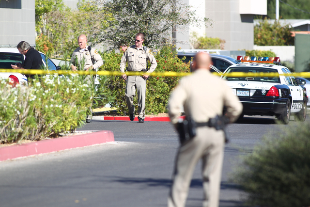 Las Vegas police respond to the scene of a shooting at a business complex at 2200 S. Rancho Dr. in Las Vegas on Monday, Oct. 13, 2014. The person who was shot was taken to University Medical Cente ...