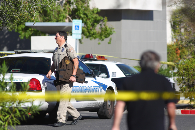 A UMC Public Safety officer carrying what appears to be bullet proof vests is seen as Las Vegas police respond to the scene of a shooting at a business complex at 2200 S. Rancho Dr. in Las Vegas o ...