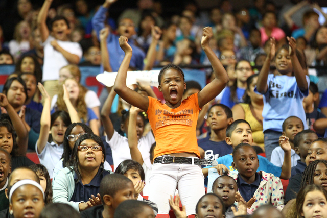 Students cheer as the Rebel Reading Challenge launch event begins in the Thomas & Mack Center at UNLV in Las Vegas on Wednesday, Oct. 15, 2014. The event, which featured people including Clark Cou ...