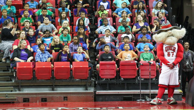Students watch as comedy magician Mac King, not pictured, magic trick during the Rebel Reading Challenge launch event at the Thomas & Mack Center at UNLV in Las Vegas on Wednesday, Oct. 15, 2014.  ...