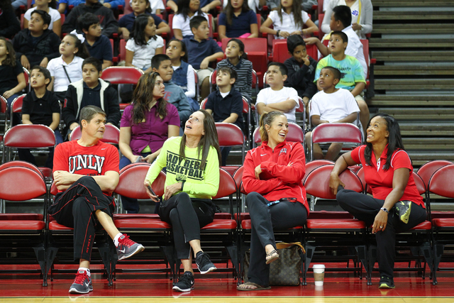 UNLV Runnin' Rebels coach Dave Rice, from left, Lady Rebels coach Kathy Olivier, Softball coach Lisa Dodd, and Track and Field coach Yvonne Wade sit courtside  as the Rebel Reading Challenge launc ...
